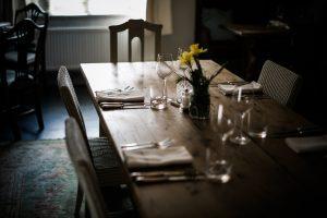 Tables set with fresh seasonal flowers at the St Tudy Inn, North Cornwall. Daniel Scott