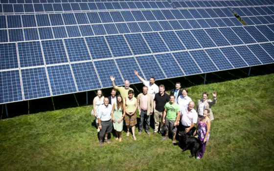 WREN and the Hawkey family stand by solar panels at The Olde House, which were installed in July 2011 to help power their business and take a significant step towards becoming carbon neutral. Tony Atkinson