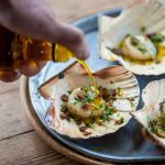 Scallops with pancetta, garlic and Mrs Middleton's Cold-Pressed Rapeseed Oil.