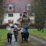 Whizz and Millie Middleton walk on the farm