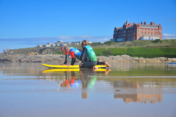 Surf lesson on Fistral Beach with the Surf Santuary. The Headland Hotel