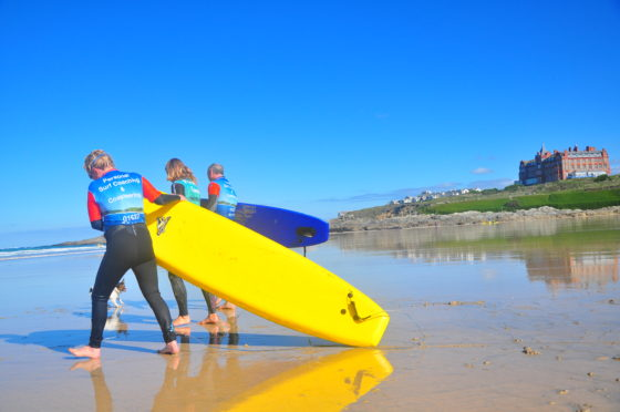 Surf lesson on Fistral Beach with the Surf Sanctuary. The Headland Hotel