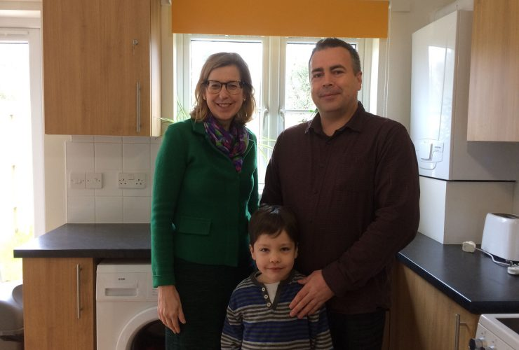 MP Sarah Newton with Ocean Housing tenant Neil Davies and his son Luca. Ocean Housing