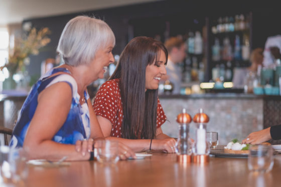 Friends and family chatting at Una Kitchen Lee Searle