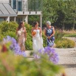 The bride, mother of the bride and bridesmaid leaving their eco-lodge at Una