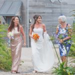 The bride, mother of the bride and bridesmaid walking to the wedding reception at Una Kitchen