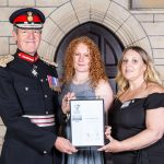 Legacy team accepting their silver armed forces award