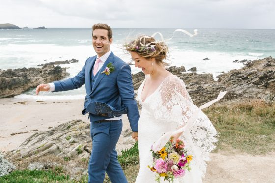Couple hand-in-hand on the beach clifftop Debs Ivelja photography