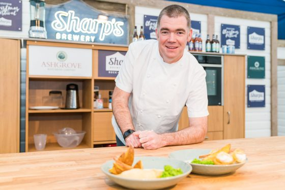 Nathan Outlaw presents some dishes on stage at Padstow Christmas Festival 2019 Lewis Harrison-Pinder - @pindygram
