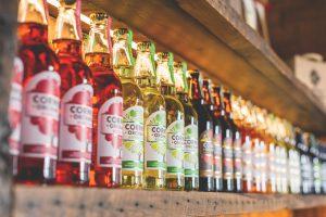 Bottles lined up on the shelf